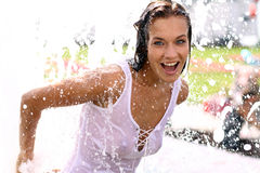 woman bathes in a city fountain Royalty Free Stock Image