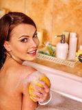 Woman bathes in a foam bath. Stock Photo