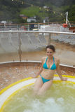 Woman bathes in jacuzzi on board of cruise ship Stock Photos