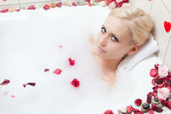 Woman bathing Stock Image