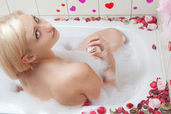 Woman bathing Stock Images
