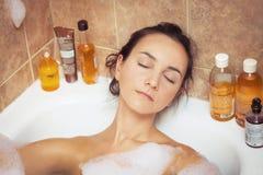 Woman bathing Stock Photos