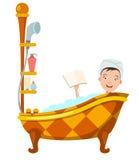 Woman bathing in bathtub Stock Image