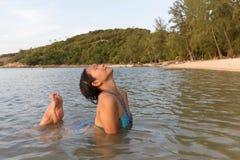 Woman bathing at beach Stock Image