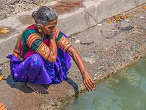 Woman bathing in the Ganges at Rishikesh Stock Images