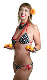 Woman in bathing suit with apricots Royalty Free Stock Image