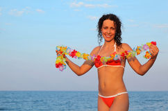 Woman in bathing suit holding garland of flower Royalty Free Stock Photos
