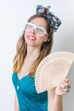 Woman in bathing suit holding hand fan Stock Image