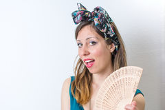 Woman in bathing suit holding a hand fan Stock Photos