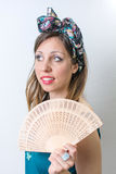 Woman in bathing suit holding a hand fan Stock Image