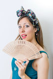 Woman in bathing suit holding a hand fan Stock Images