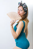 Woman in bathing suit holding a hand fan Stock Photo