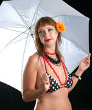 Woman in bathing suit with white umbrella Royalty Free Stock Photos