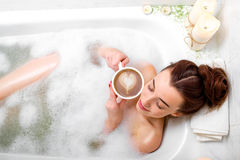 Woman bathing Stock Photos