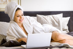 Woman in bathrobe Stock Photo
