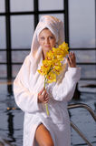 The woman in bathrobe Stock Images