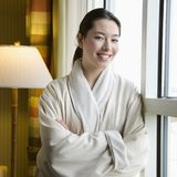 Woman in bathrobe. Stock Photos