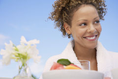 Woman In Bathrobe At Breakfast Table Royalty Free Stock Image