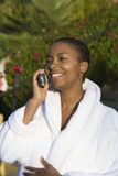 Woman In Bathrobe On A Call Stock Photos