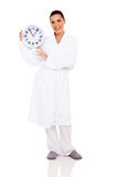 Woman bathrobe clock Stock Photos