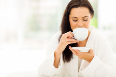 Woman bathrobe coffee Stock Images