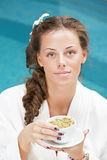 Woman in bathrobe with cup of tea Royalty Free Stock Photography