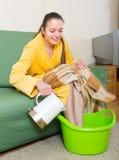 Woman in bathrobe with feet in basin Stock Photos