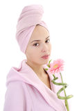 Woman in bathrobe with gerberas and bamboo Stock Images