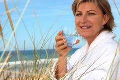 Woman with a bathrobe Stock Photo
