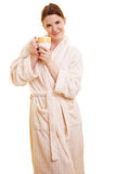 Woman in bathrobe holding cup Royalty Free Stock Images