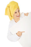 Woman in bathrobe holding empty banner Royalty Free Stock Photo