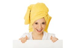 Woman in bathrobe holding empty banner Stock Photos