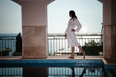 woman in bathrobe at  pool  Stock Photography