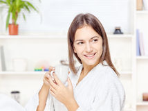Woman in bathrobe relaxing at home Stock Photos