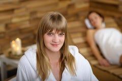 Woman in bathrobe at spa room Royalty Free Stock Photos