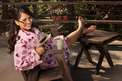 Woman in Bathrobe with Tea or Coffee Royalty Free Stock Photography