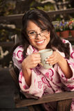 Woman in Bathrobe with Tea or Coffee Stock Images