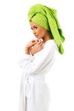 Woman in bathrobe and towel on head Stock Image