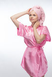 Woman in bathrobe and towel Royalty Free Stock Images