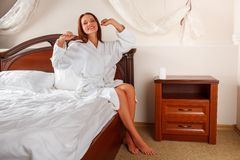 woman in bathrobe waking up Stock Photography