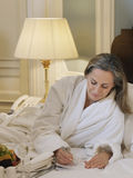 Woman In Bathrobe Writing Notes In Bed Stock Photos