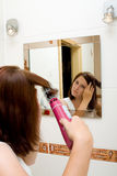 Woman in bathroom. Woman in the mirror drying hair stock photos