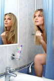 Woman in bathroom Royalty Free Stock Photography