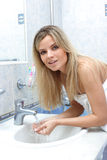 Woman in the bathroom Stock Image