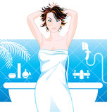 Woman in bathroom Stock Photo
