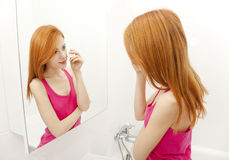 Woman in bathroom. Stock Photos