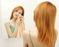 Woman in bathroom. Royalty Free Stock Photo