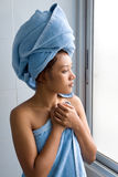 Woman in bathroom Stock Images