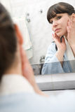 Woman in bathroom Royalty Free Stock Image