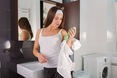 Woman in the bathroom. Beautiful woman choosing beauty products in her bathroom in the morning Stock Photos